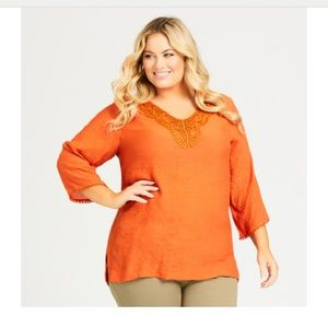 Orange flowy top